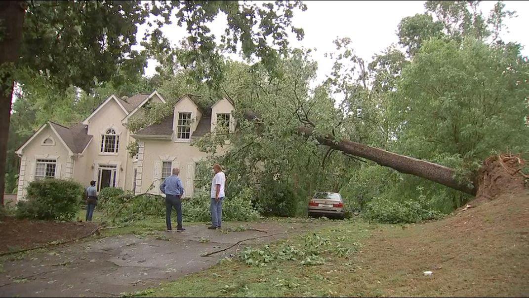 1 dead, buildings damaged and trees down after at least 1 tornado slams metro Atlanta